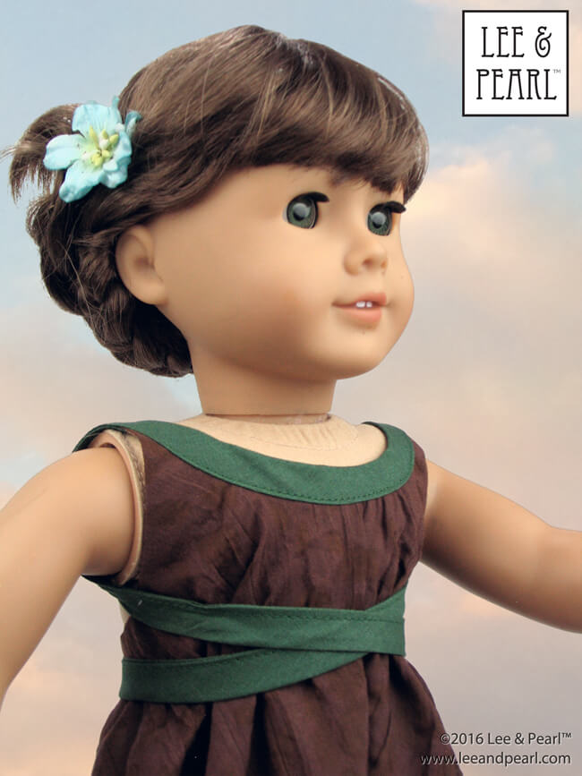 Make this stylish version of the Lee & Pearl Pattern 1032: Desert Sunrise Top or Maxi Dress for 18 inch dolls, like our American Girl doll, by criss-crossing the halter ties around the front instead of in back. Get this FREE tweak — and a trendy high-low handkerchief hem adaptation — in our June 2016 newsletter, available on our website at www.leeandpearl.com. And find Pattern 1032 in our Etsy shop at https://www.etsy.com/shop/leeandpearl
