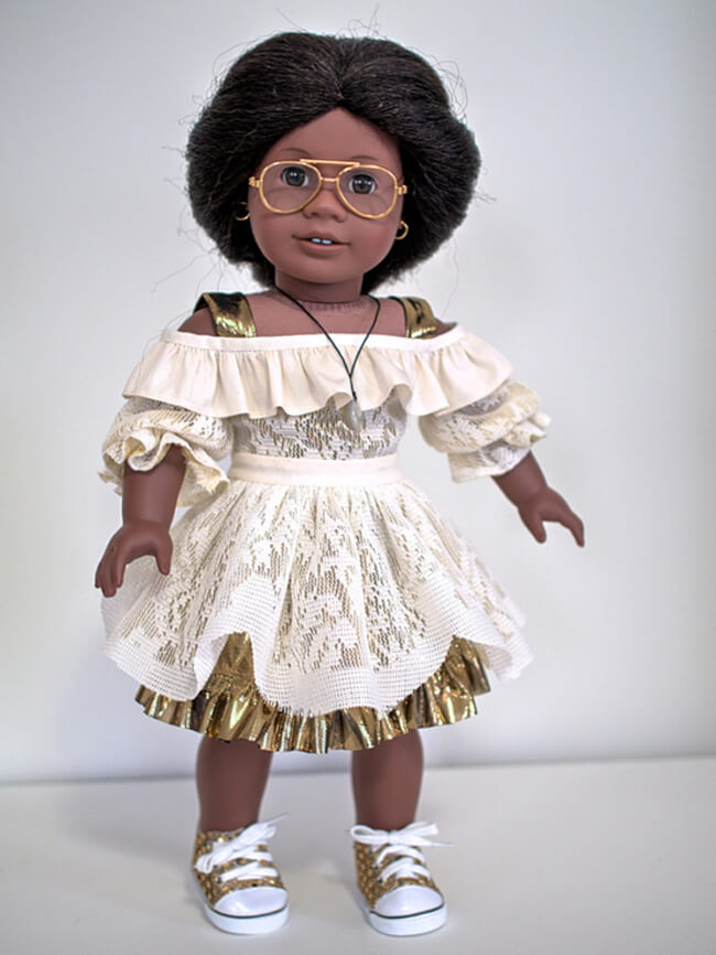 Ralphie50 made this stylish dress for her American Girl doll Addy using gold fabric, a salvaged drapery sheer, and our 2016 FREE pattern for Lee & Pearl mailing list subscribers — 1035: Olá Brasil! Samba Top, Bahia Dress, Baiana Headwrap and Jewelry Tutorials for 18 Inch Dolls. Join our mailing list at www.leeandpearl.com to get your own copy of this wonderful pattern!