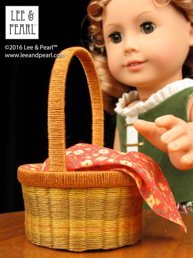 Easter basket — or all-season basket! Our American Girl doll loves the wicker / willow-look basket we made using Lee & Pearl's FREE printable template and tutorial, substituting ordinary embroidery floss for the ribbon in the pattern. Get your own printable package — which includes several shapes and sizes, including this NEW large, straight-sided basket, perfect for 18 inch fairy tale heroines — in the Lee & Pearl March 2016 Newsletter.