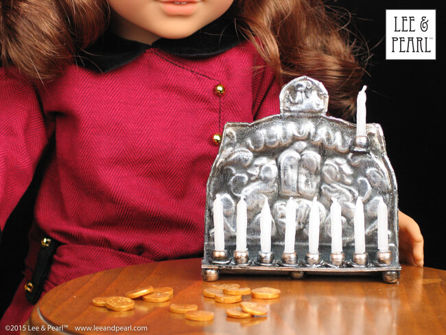 Happy Chanukah from Lee & Pearl! Make your 18 inch doll, like our American Girl® Rebecca Rubin, her very own pressed metal Chanukah Menorah (Chanukiya) using a dollar store cookie sheet, cardboard, glue, plastic beads, a knitting needle, metallic paints and the techniques in our easy VIDEO TUTORIAL.